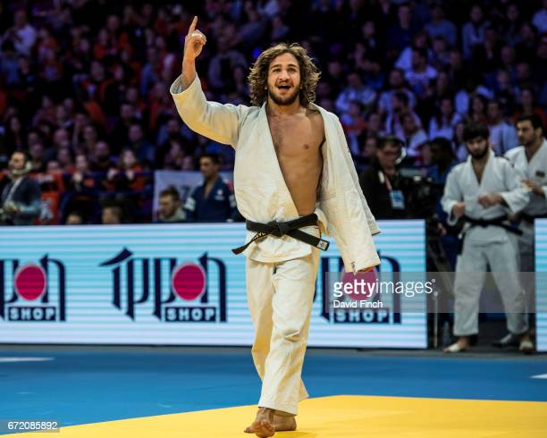 Hidayat Heydarov of of Azerbaijan celebrates his victory against Dmytro Kanivets of Ukraine in a team contest that neither side won and is to be...