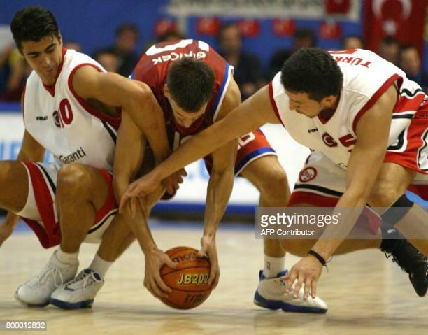 Hidayet Turkoglu from Turkey and NBA Sacramento Kings and his teammate Ibrahim Kutluay block Gordan Giricek from Croatia and NBA Orlando Magic during...