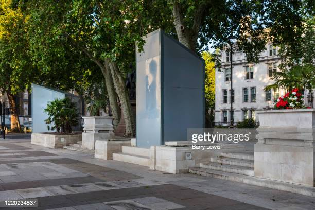 Hidden beneath the cover is a bronze statue by the sculptor Philip Jackson of Mahatma Gandhi an Indian lawyer anticolonial nationalist who employed...