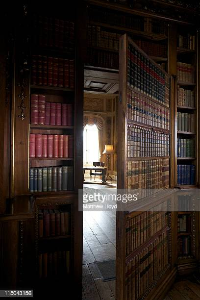 Hidden door from library to the music room is opened at Highclere Castle on March 15, 2011 in Newbury, England. Highclere Castle has been the...
