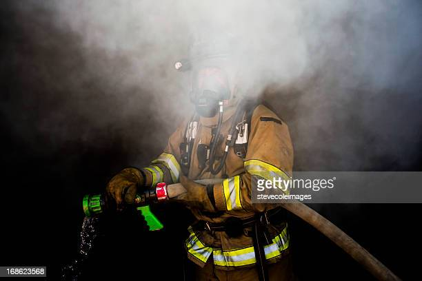 hidden firefighter - fire station stock photos and pictures