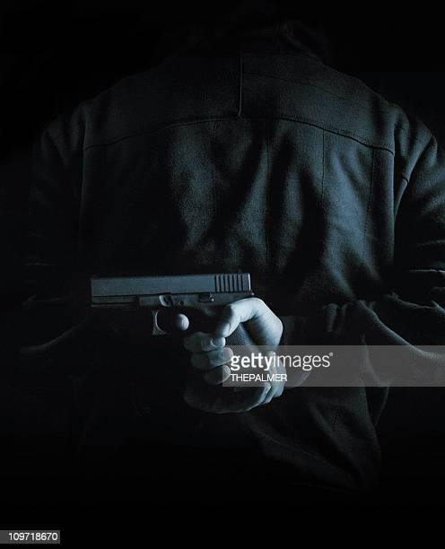 hidden gun - gunman stock pictures, royalty-free photos & images
