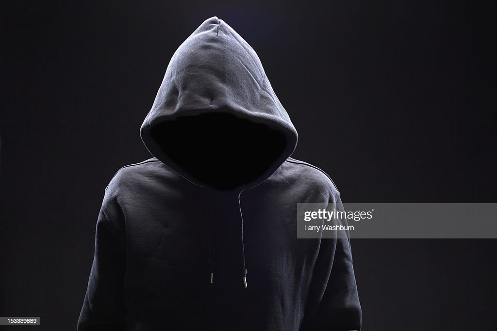 Hidden man in hooded top : Stock Photo