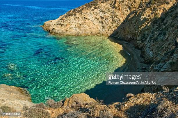 Hidden sandy beach in a cove with transparent green water, view from above. Serifos island, Greece., Serifos, Greece on September 15, 2018.