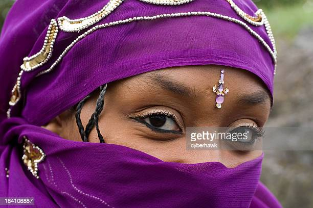 hidden smile - muslim woman darkness stock photos and pictures