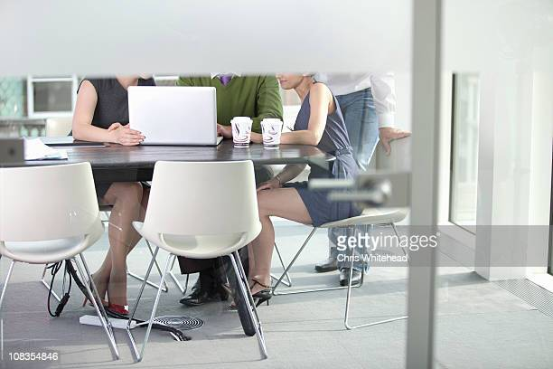 hidden workmates looking at laptop - low section stock pictures, royalty-free photos & images