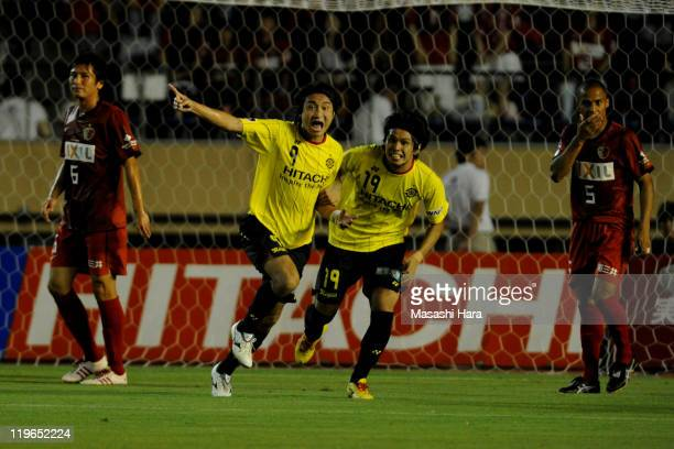Hideaki Kitajima celebrates first goal of Kashiwa Reysol with Masato Kudo during the JLeague match between Kashiwa Reysol and Kashima Antlers at the...