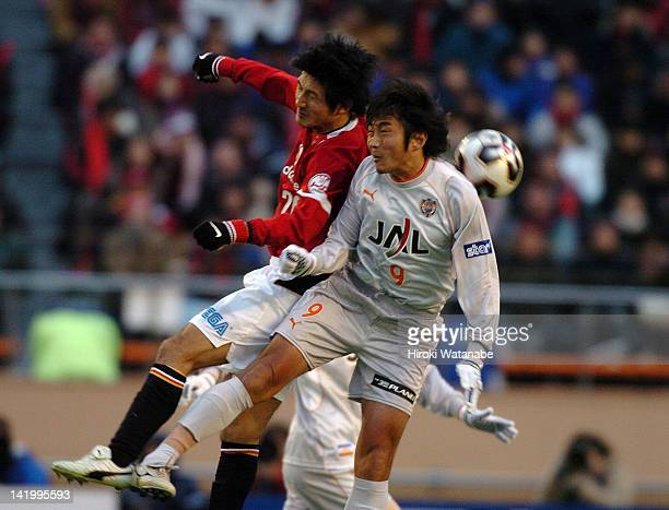 Hideaki Kitajima of Shimizu SPulse and Satoshi Horinouchi of Urawa Red Diamonds compete for the ball during the 85th Emperor's Cup final match...