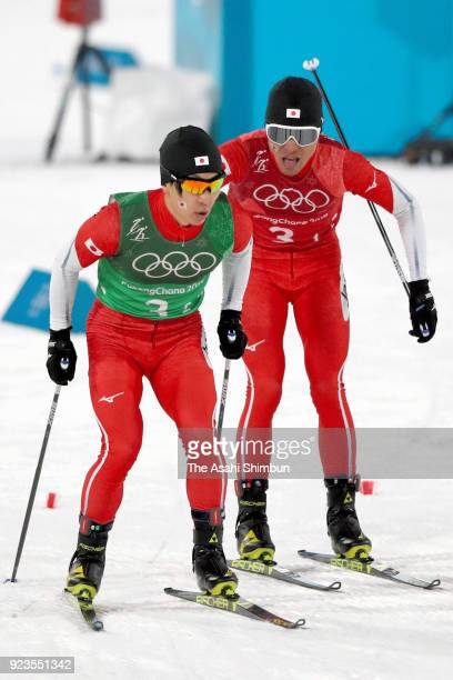 Hideaki Nagai and Yoshito Watabe of Japan compete during the Nordic Combined Team Gundersen Large Hill/4x5km CrossCountry on day thirteen of the...