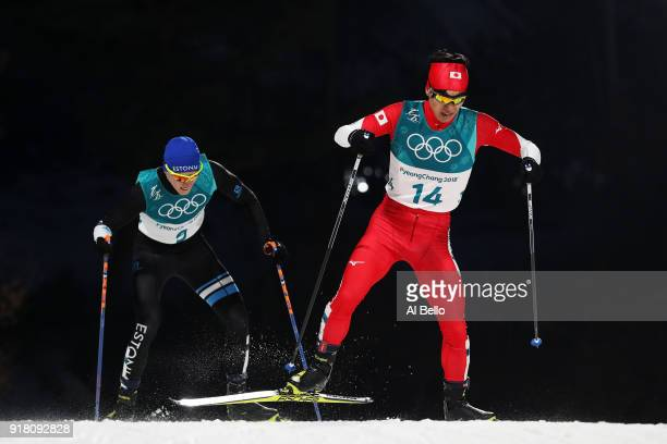 Hideaki Nagai of Japan and Kristjan Ilves of Estonia compete during the Nordic Combined Individual Gundersen Normal Hill and 10km Cross Country on...