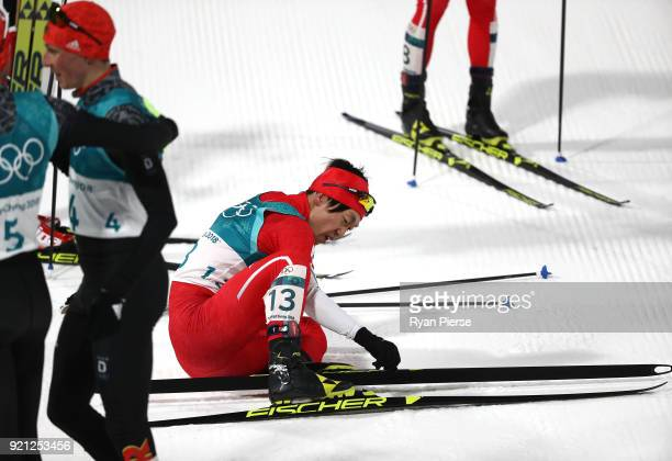 Hideaki Nagai of Japan reacts after crossing the finish line during the Nordic Combined Individual Gundersen 10km CrossCountry on day eleven of the...