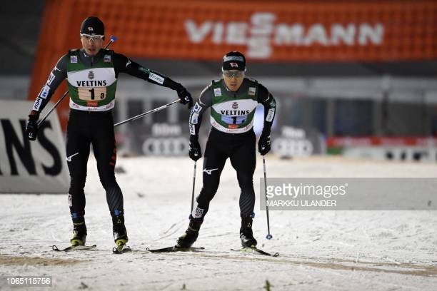 Hideaki Nagai of Japan sends anchor Akito Watabe to the track during the Men's Nordic Combined Team Competition at FIS Nordic Skiing World Cup in...