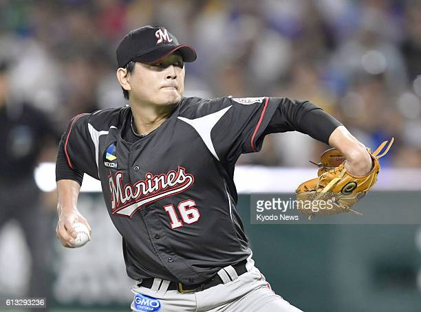 Hideaki Wakui of the Lotte Marines pitches against the SoftBank Hawks in Game 1 of the Pacific League Climax Series first stage at Yafuoku Dome in...