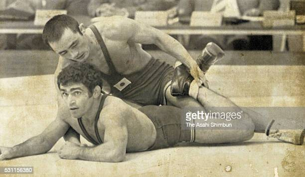 Hideaki Yanagida of Japan and Ramezan Kheder of Iran compete in the Wrestling Men's Freestyle Bantamweight six round match during the Munich Summer...