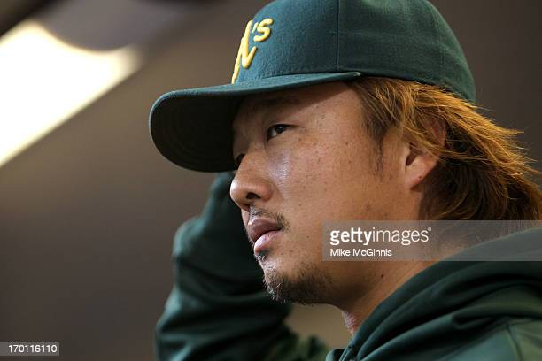 Hidecki Okajima of the Oakland Athletics walks the dugout before the interleague game against the Milwaukee Brewers at Miller Park on June 05 2013 in...