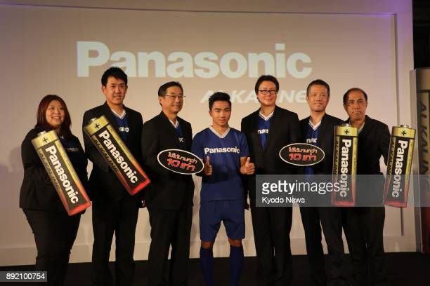 Hidekazu Ito managing director of Panasonic Siew Sales Co and other Panasonic officials pose with Chanathip Songkrasin a Thai soccer star playing in...