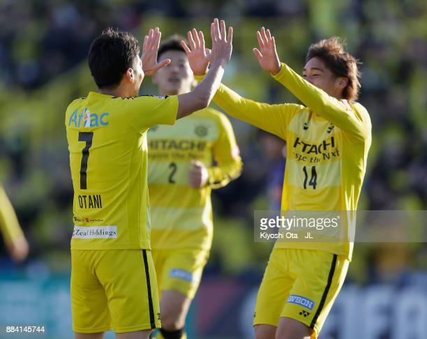 Hidekazu Otani of Kashiwa Reysol celebrates scoring the opening goal with his team mate Junya Ito during the JLeague J1 match between Kashiwa Reysol...
