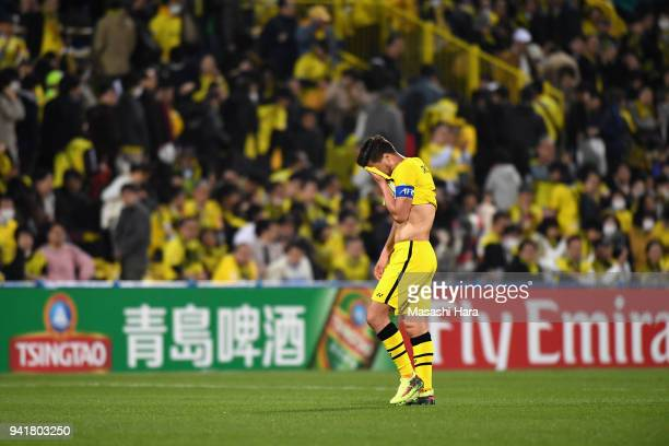 Hidekazu Otani of Kashiwa Reysol shows dejection after his side's 02 defeat in the AFC Champions League Group E match between Kashiwa Reysol and...