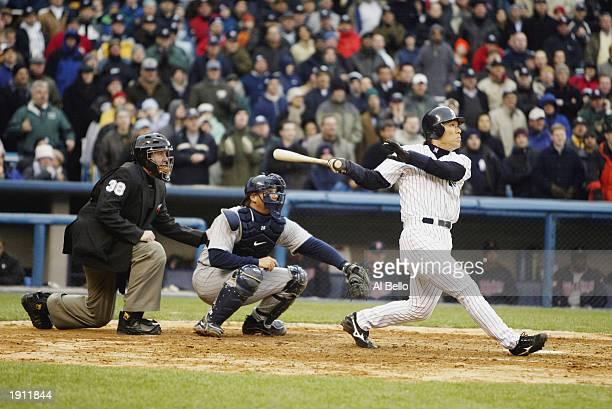Hideki 'Godzilla' Matsui of the New York Yankees hits a 32 pitch for his first grand slam to right center field off of Joe Mays of the Minnesota...