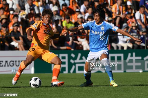 Hideki Ishige of Shimizu SPulse and Shunsuke Nakamura of Jubilo Iwata compete for the ball during the JLeague J1 match between Shimizu SPulse and...