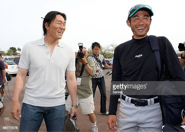 Hideki Matsui of Los Angeles Angels of Anaheim and Ichiro Suzuki of Seattle Mariners talk after a Spring Camp game between Seattle Mariners and Los...