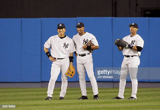Hideki Matsui Bernie Williams and Gary Sheffield of the New York Yankees stand in the outfield against the Los Angeles Angels of Anaheim during Game...