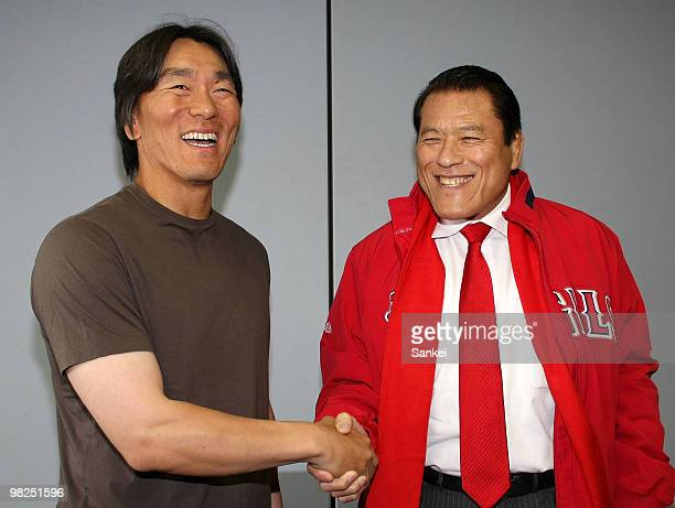Hideki Matsui of Los Angeles Angels of Anaheim shakes hands with ex professional wrestler Antonio Inoki after a Spring Camp match between Cansas City...