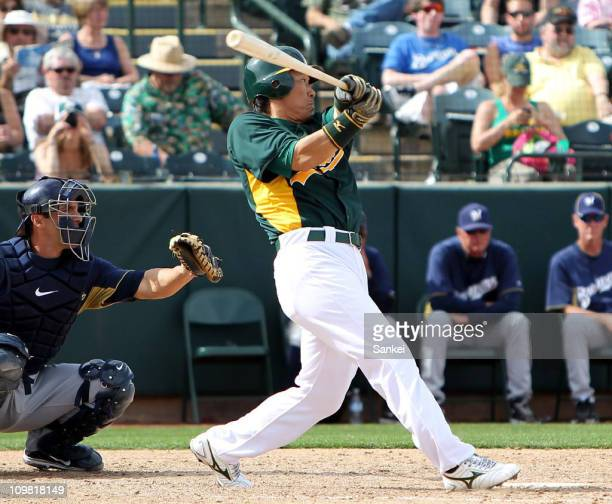 Hideki Matsui of Oakland Athletics at bat during the spring training game with Milwaukee Brewers at Phoenix Municipal Stadium on March 6 2011 in...