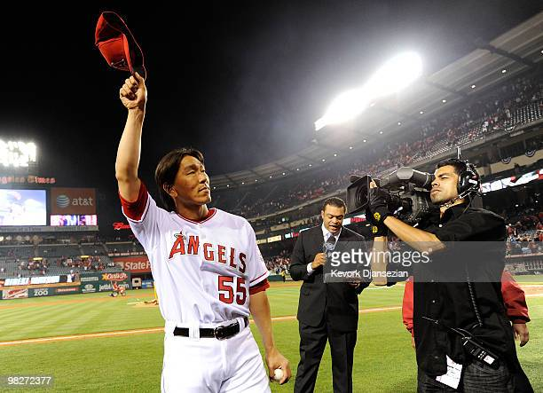 Hideki Matsui of the Los Angeles Angels of Anaheim acknowledges the fans following their 63 win over the Minnesota Twins on Opening Day at Angel...