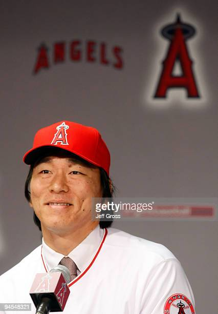 Hideki Matsui of the Los Angeles Angels of Anaheim addresses the media during a press conference after he signed with the Angels at Angel Stadium of...