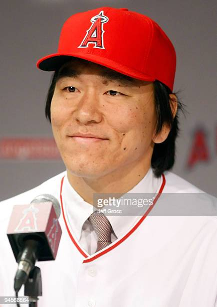 Hideki Matsui of the Los Angeles Angels of Anaheim addresses the media during a press conference at Angel Stadium of Anaheim on December 16 2009 in...