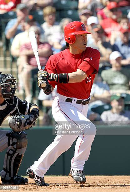 Hideki Matsui of the Los Angeles Angels of Anaheim bats against the Chicago White Sox during the first inning of the MLB spring training game at...