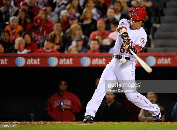 Hideki Matsui of the Los Angeles Angels of Anaheim hits a home run in the eighth inning off Jose Mijares of the Minnesota Twins on Opening Day at...