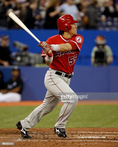 Hideki Matsui of the Los Angeles Angels of Anaheim hits a rbi double against the Toronto Blue Jays during a MLB game at the Rogers Centre April 18...