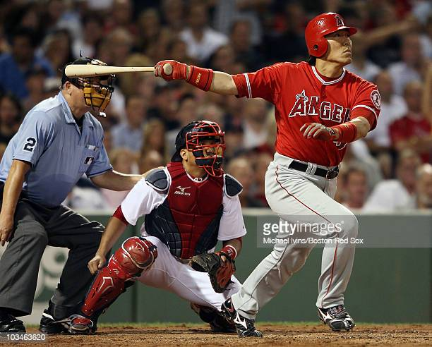 Hideki Matsui of the Los Angeles Angels of Anaheim hits a three run homer in the sixth inning as Victor Martinez of the Boston Red Sox defends on...