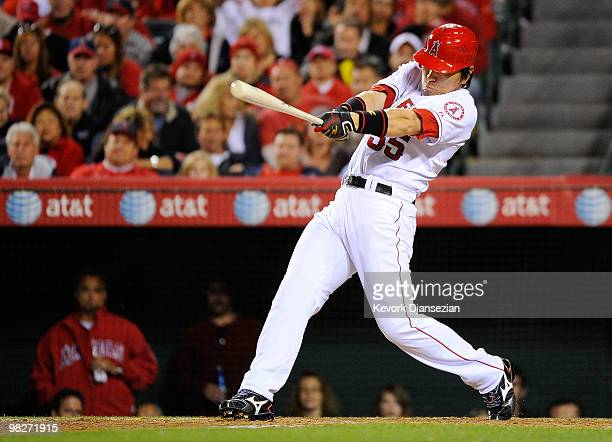 Hideki Matsui of the Los Angeles Angels of Anaheim hits an RBI single to score Erick Aybar during their game against the Minnesota Twins on Opening...