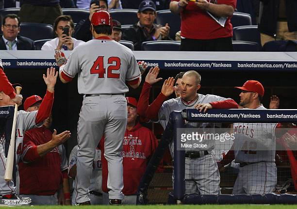 Hideki Matsui of the Los Angeles Angels of Anaheim is congradulated by his teammates after hitting a secondinning homerun against the New York...