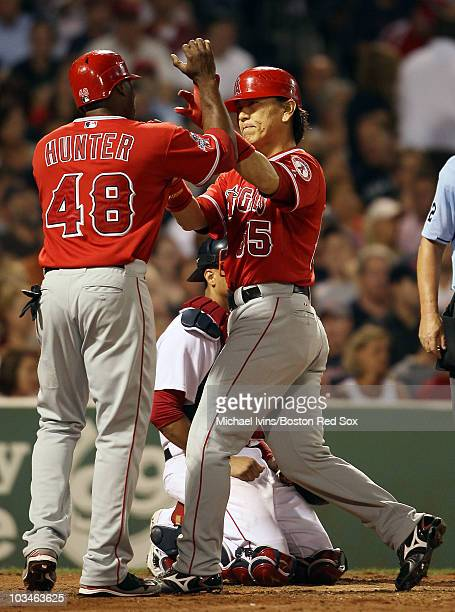 Hideki Matsui of the Los Angeles Angels of Anaheim is congratulated by teammate Torii Hunter after Matsui hit a three run homer in the sixth inning...