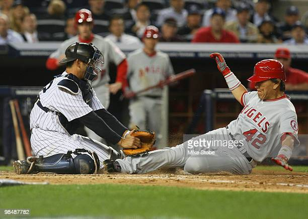Hideki Matsui of the Los Angeles Angels of Anaheim is tagged out at home plate by Jorge Posada of the New York Yankees in the fourth inning on April...