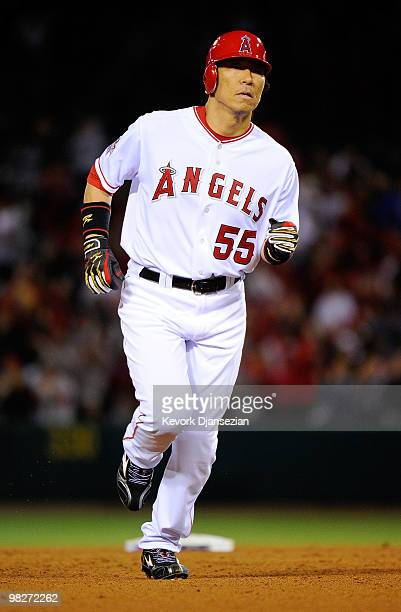 Hideki Matsui of the Los Angeles Angels of Anaheim runs the bases after hitting a home run in the eighth inning off Jose Mijares of the Minnesota...