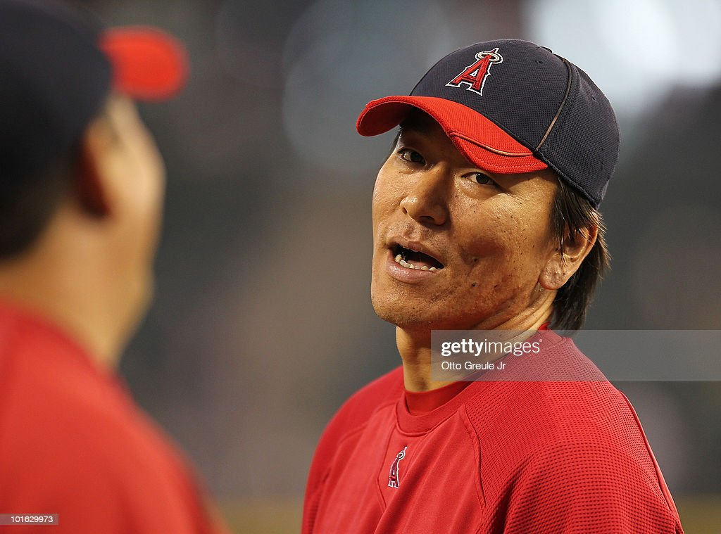 Hideki Matsui #55 of the Los Angeles Angels of Anaheim talks with hitting coordinator Todd Takayoshi during batting practice prior to the game against the Seattle Mariners at Safeco Field on June 4, 2010 in Seattle, Washington.