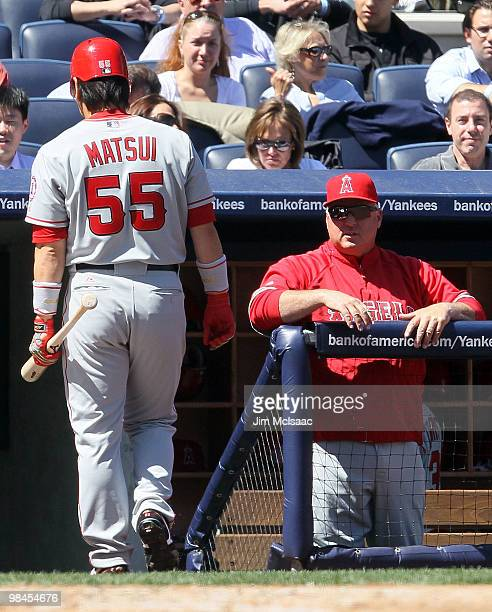 Hideki Matsui of the Los Angeles Angels of Anaheim walks back to the dugout after striking out in the third inning against the New York Yankees as...