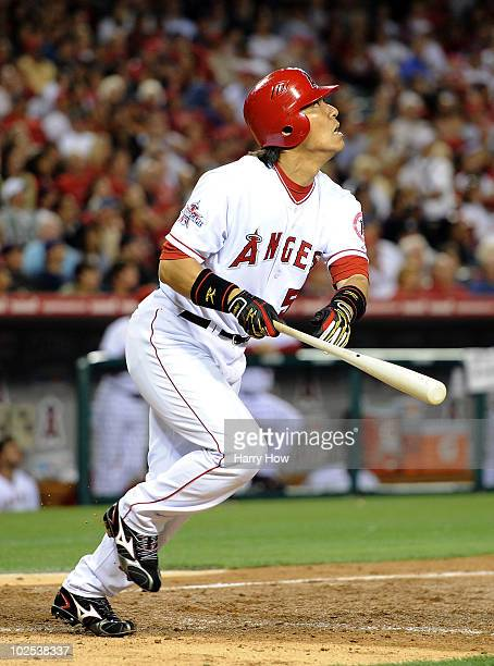 Hideki Matsui of the Los Angeles Angels watches his fly ball against the Texas Rangers at Angel Stadium on June 29 2010 in Anaheim California