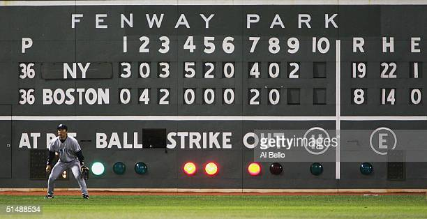 Hideki Matsui of the New York Yankees awaits a play while the scoreboard reads 198 Yankees over the Boston Red Sox in the ninth inning during game...