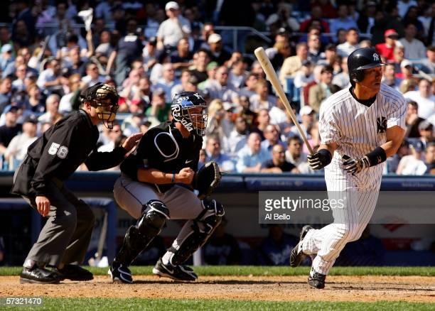 Hideki Matsui of the New York Yankees bats as catcher John Buck of the Kansas City Royals and homeplate umpire Dan Iassogna watch during the home...