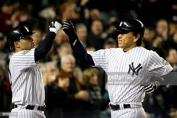Hideki Matsui of the New York Yankees celebrates with Jerry Hairston Jr. #17 after hitting a solo home run in the sixth inning against the...