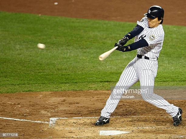 Hideki Matsui of the New York Yankees hits a 2run single in the bottom of the third inning against the Philadelphia Phillies in Game Six of the 2009...