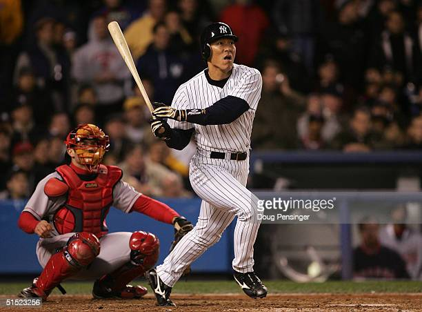 Hideki Matsui of the New York Yankees hits a double in the seventh inning against the Boston Red Sox during game seven of the American League...