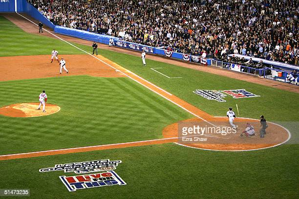 Hideki Matsui of the New York Yankees hits a threerun double against pitcher Curt Schilling of the Boston Red Sox in the third inning during game one...