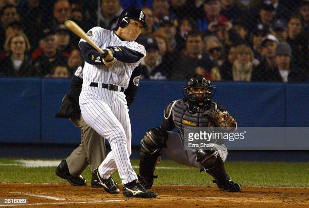 Hideki Matsui of the New York Yankees hits a threerun home run in the 1st inning against the Florida Marlins during game 2 of the Major League...
